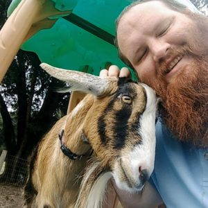 The Kilted Realtor and Cookie the Goat taking a selfie